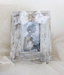 Wedding ...use old barn/fence wood for frames...black and white photos...bows/flowers wedding colors