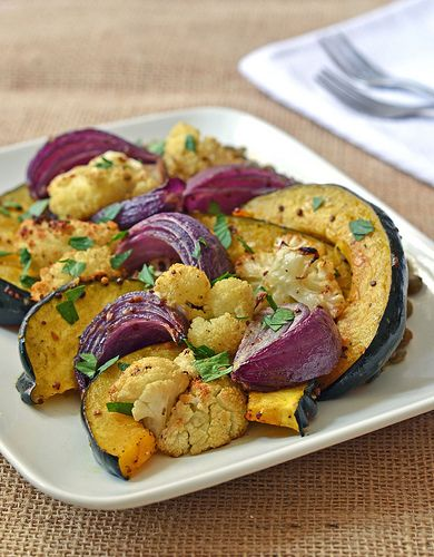 A flavorful combination of roasted caramelized acorn squash, cauliflower, and red onions tossed in a mustard vinaigrette with warm lentils.