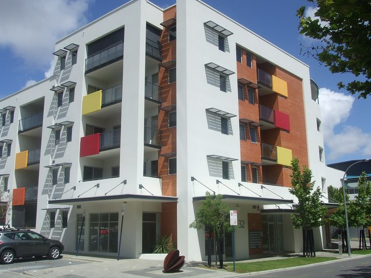 Image 1 apartment building. The playful building uses the varying heights of the building mass, combinations of materials and colours, and detail to create sculptural visual interest.