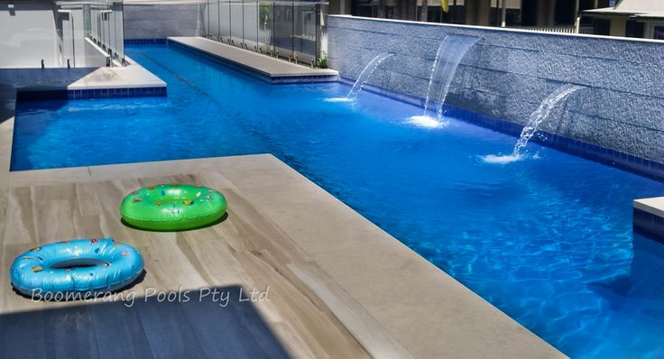 Custom Concrete Pool with Water Feature Wall