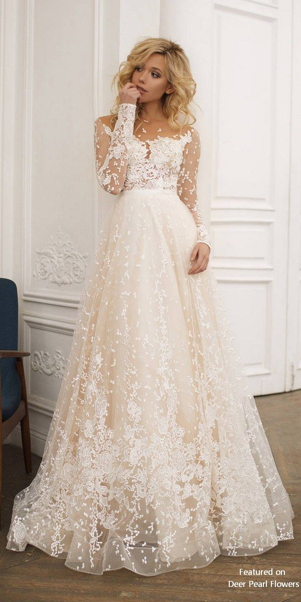 This wedding with long sleeves , low back and A line skirt is created for bride …