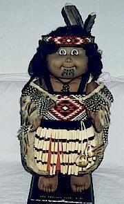 A doll displaying Taniko patterns