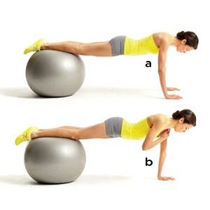 Plank Shoulder Taps::::Get into a pushup position with your hands shoulder-width apart on the floor and your shins resting on top of the ball (a). Keeping your hips square to the floor, lift your right hand and tap your left shoulder (b). Return to start and repeat with the other arm. Continue alternating for a total of 26 reps.
