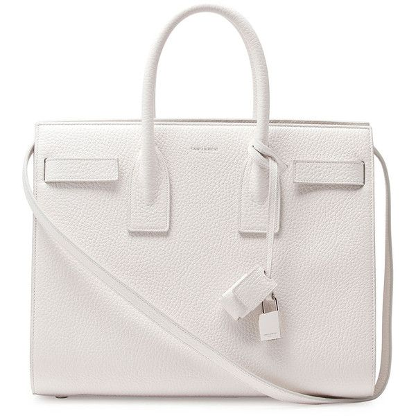 """Saint Laurent pebbled leather tote with silver hardware. Removable crossbody/shoulder strap with 19"""" drop. Tubular tote handles with 4"""" drop. Removable padlock…"""