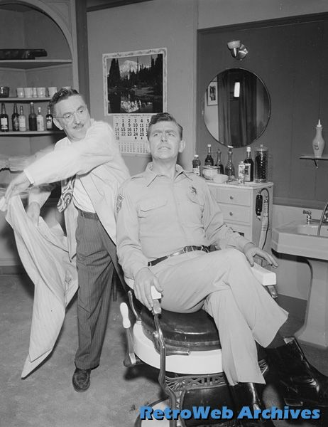 Howard McNear and Andy Griffith / Getting a hair cut in Floyd's barbershop. Maybe both side burns will turn out even.