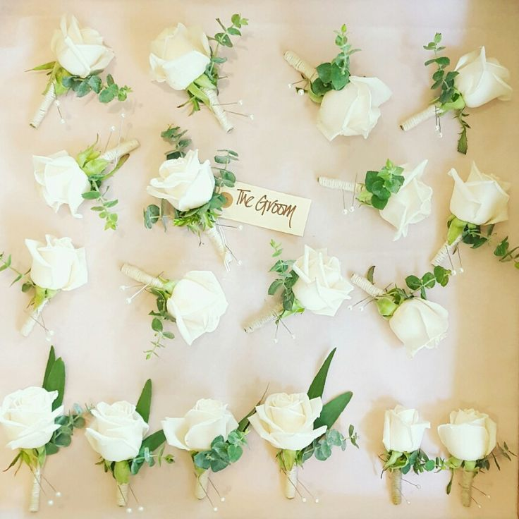 A box full of classically beautiful Rose & Eucalyptus buttonholes with Twine wraps for a White and Green themed Wedding.