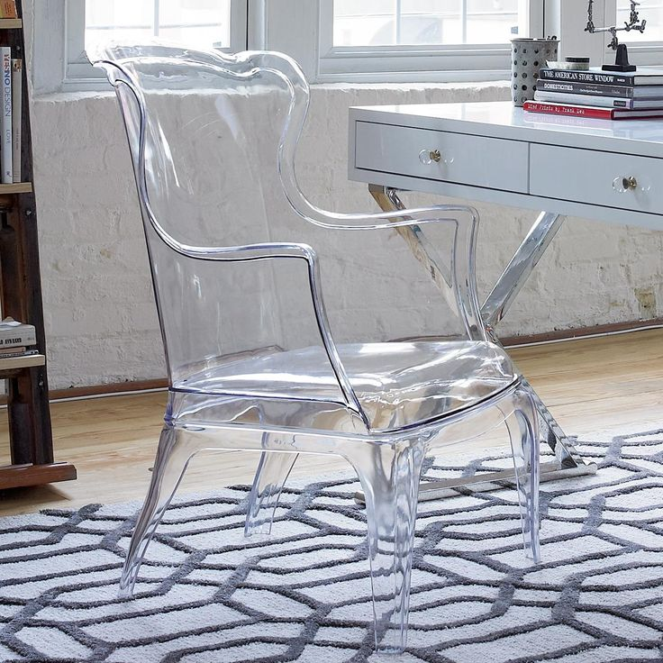 Acrylic Arm Chair With classic form and a clear twist, this acrylic wing back arm chair is a bold style statement for any decor! Made from clear acrylic (polycarbonate), this chair is suitable for indoor or outdoor use as an elegant, modern statement.
