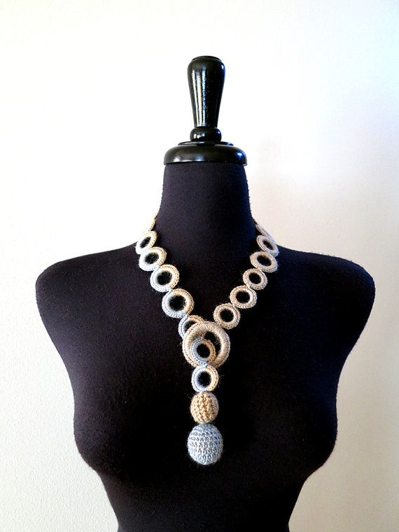 This elegant and fashionable necklace can compliment any outfit from casual denim to semi-formal dress. You can wear it in different ways. Just take a look at the pictures to get some ideas. Made from very soft premium wool yarn that gradually changes color from light taupe to gray