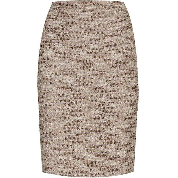 A fine metallic weave lends a subtle shimmer to this pencil skirt from St. John. Rippling in shades of pink and green, it makes for a very elegant separate. Si…