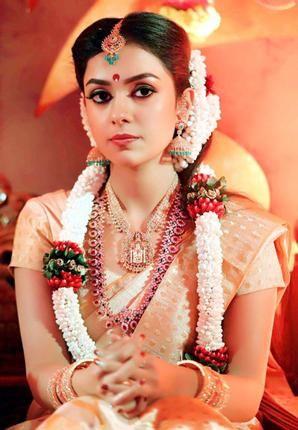 South Indian bride. Gold Indian bridal jewelry.Temple jewelry. Jhumkis.Cream and gold silk kanchipuram sari.Braid with fresh flowers. Tamil bride. Telugu bride. Kannada bride. Hindu bride. Malayalee bride.Kerala bride.South Indian wedding.