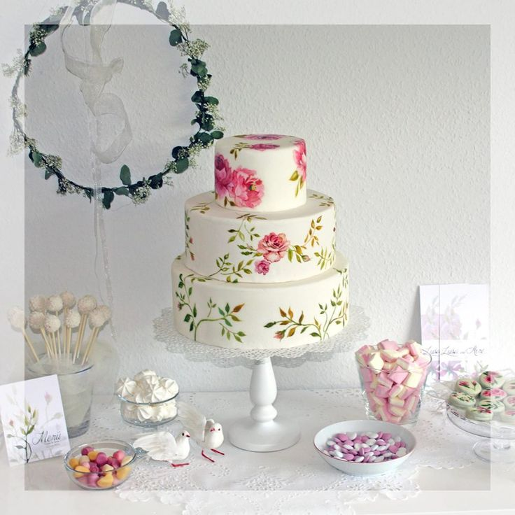 Romantic wedding cake with hand painted roses and floral ornaments by www.yavescakeink.de