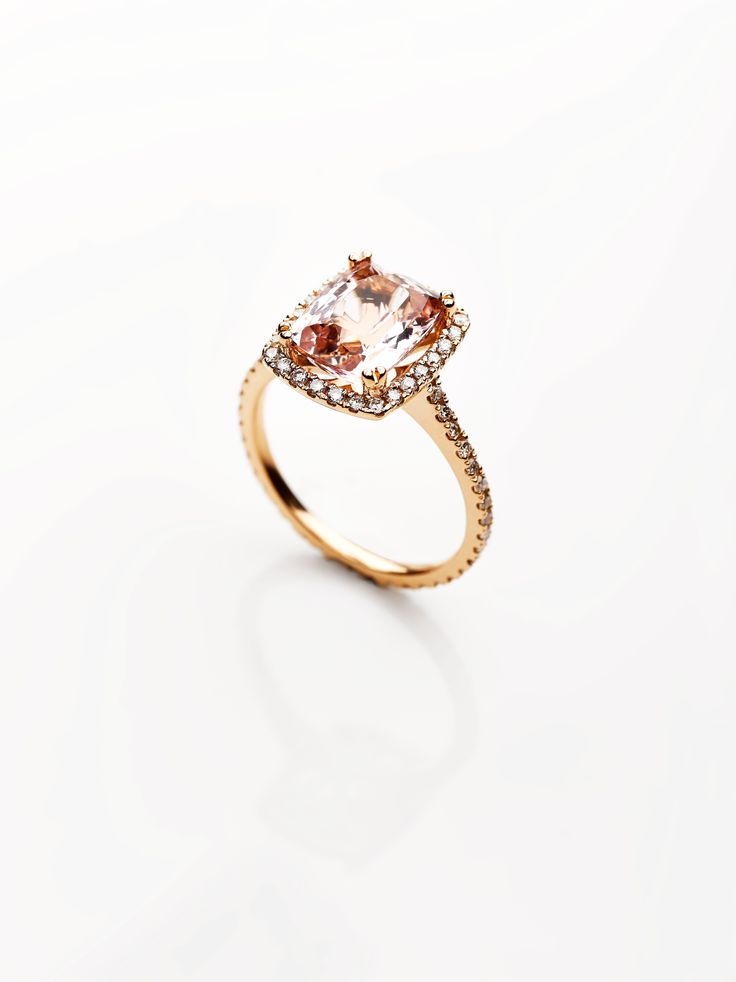 A stunning 2.88ct cushion cut centre stone in a halo setting with diamonds surrounding the stone and around the full length of the 18ct rose gold band.#morganite #engagementring #exclusivitybydesigns #diamonds #southafricanjewellery