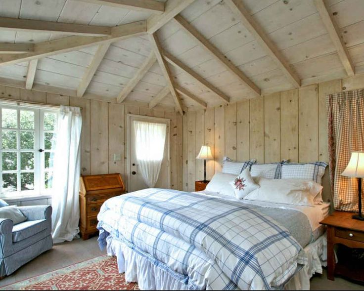 cottage bedroom with paneled walls and ceilings Lilacs & Laughter: A Cottage in Carmel-by-the-Sea