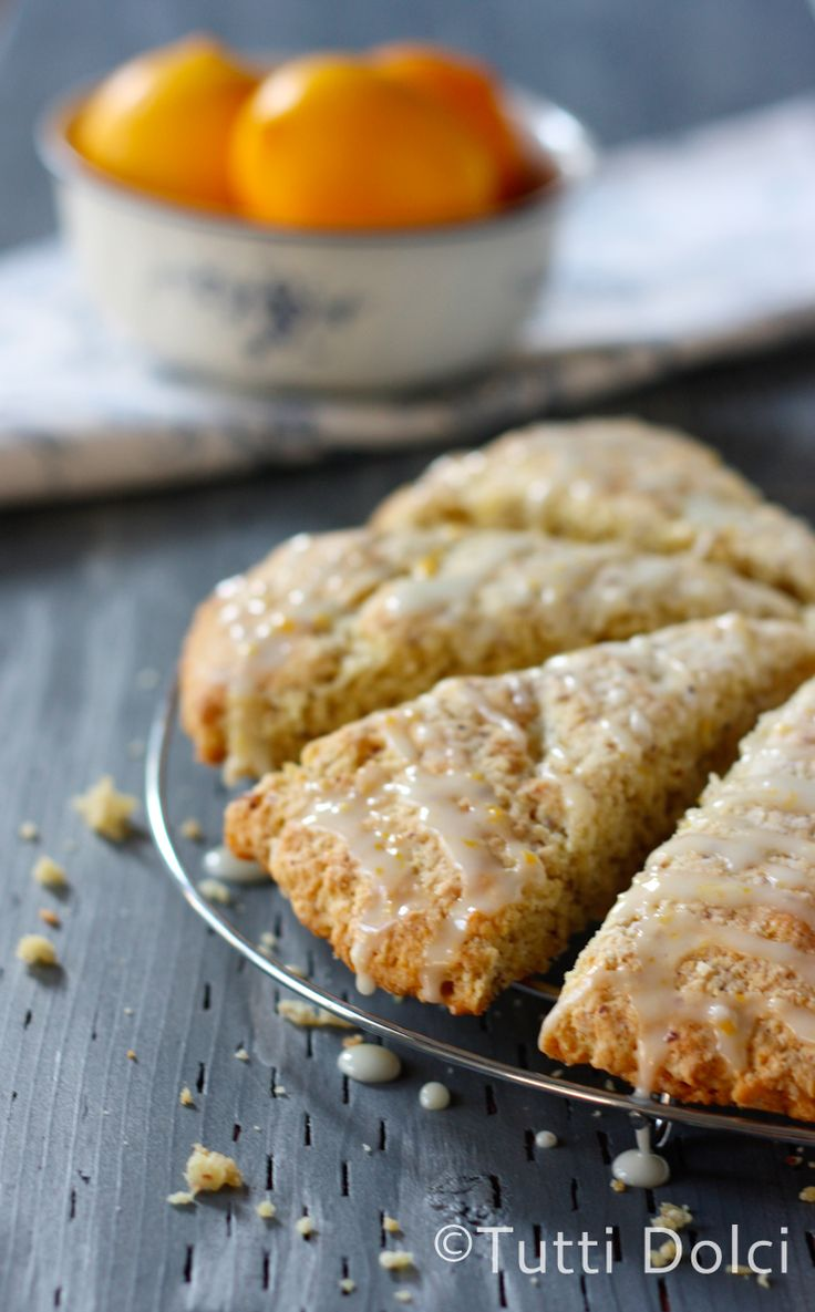 Meyer Lemon Scones!These buttery and tender scones are my ideal breakfast. Meyer lemon zest perfumes the scones while almond meal adds a slightly nutty character. The bright glaze adds just enough sweetness to a breakfast offering.