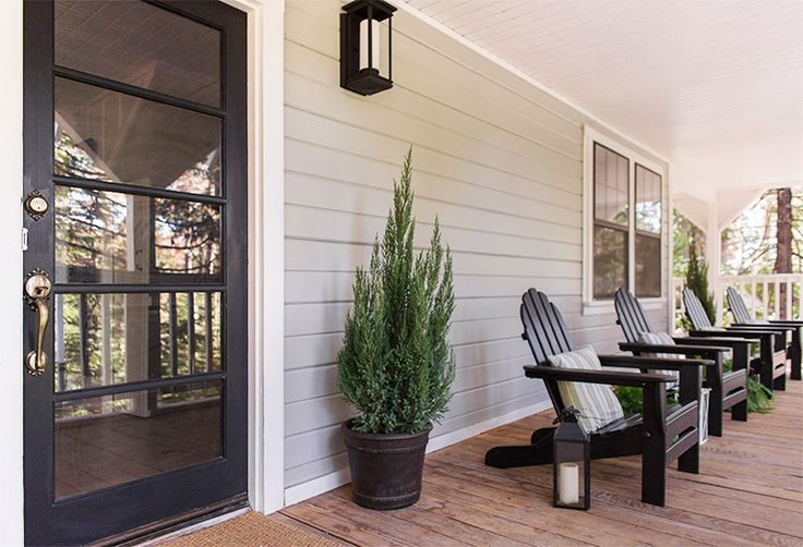 Black front door & lanterns, adirondack chairs, gray and white color scheme