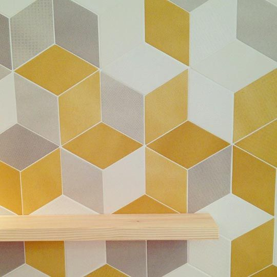 These flat yellow tiles with a 3d look are from the debut of new the new Tex collection by Raw Edges for Mutina
