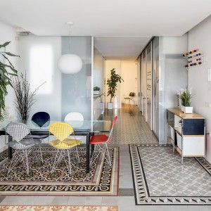 Narch+creates+a+collage+of+decorative+tiles+by+removing+walls+in+a+Barcelona+apartment