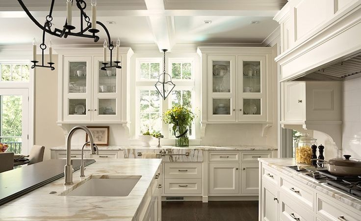 kitchens - coffered ceiling glass-front kitchen cabinets white kitchen island stone countertops gold veining iron chandelier  Amazing kitchen