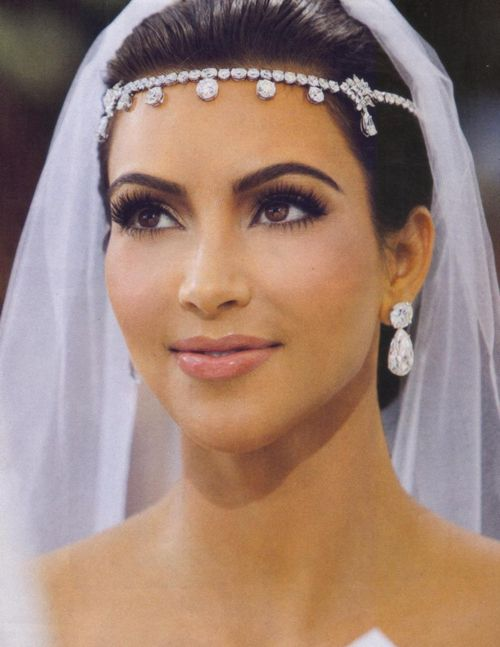 See All Three of Kim Kardashian's Wedding Dresses Plus More Photos from the…