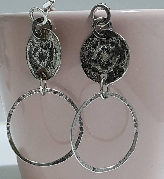 Check out this item in my Etsy shop https://www.etsy.com/listing/544166270/tribal-organic-circles-earrings-hammered