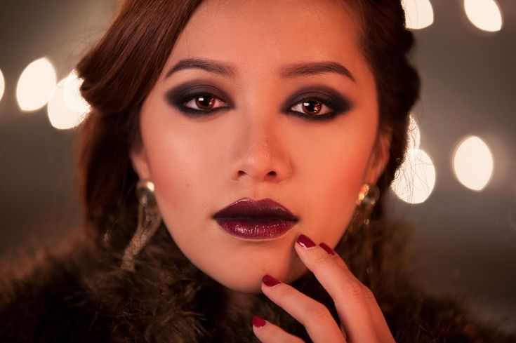 Skyfall Bond Girl Look This look is inspired by the Bond girl from the new Skyfall movie. She has a dark vampy look that's perfect if you need a sensual holiday party look. Who else is going to rock the dark lip this season?!