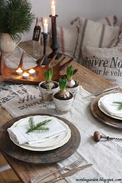 A sprig of pine & barely blooming bulbs. love the moose antler with the votives on it.