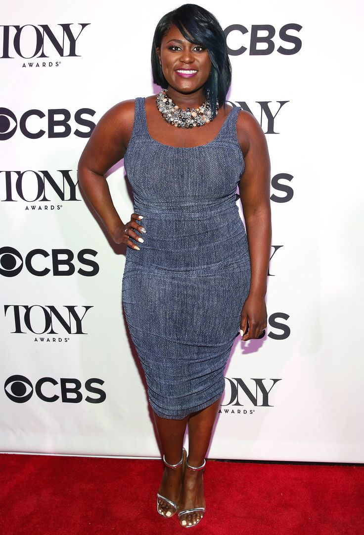 DANIELLE BROOKS in a skin-tight navy dress, accessorized with a statement necklace and silver sandals at the Tony Honors cocktail party in N.Y.C.