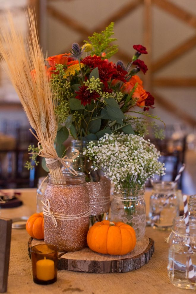 DIY Glitter mason jar fall wedding centerpiece with pumpkin and baby's breath