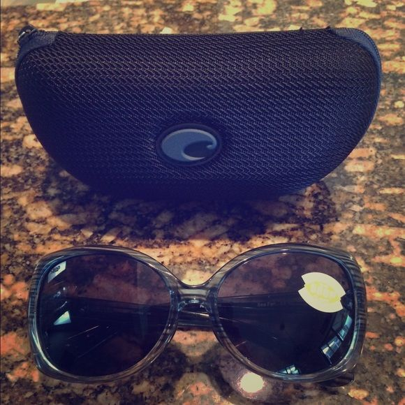Costa Del Mar Sea Fan Sunglasses NEW! 100% authentic Costa 'Sea Fan' Polarized sunglasses. Never worn. NO scratches or damage of any kind. Includes hard case and white Costa sticker. Grey/Blue frames with woodgrain look. Grey plastic polarized lenses. ☀️ Costa Del Mar Accessories Sunglasses