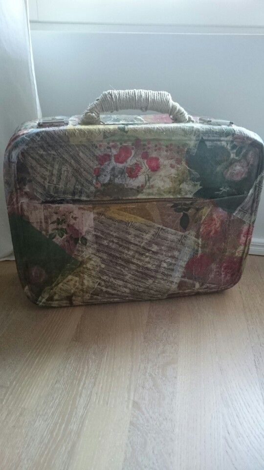 Old small suitcase covered by napkins.