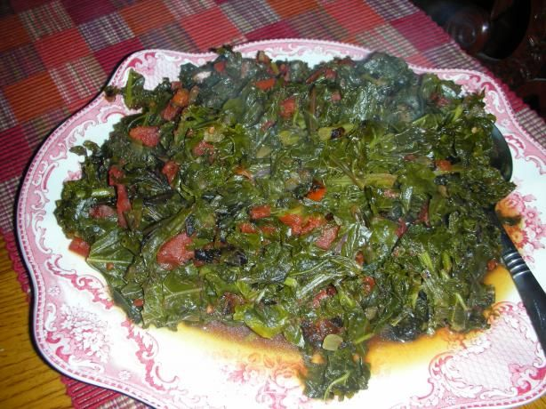 "Kenyan Greens Simmered With Tomatoes (Sukuma Wiki) from Food.com:   								Posted for ZWT7-Africa.Sukuma wiki, Swahili for ""stretch-the-week,"" is a ubiquitous Kenyan dish. Nutritious and tasty, it is a way of ""stretching"" out kitchen resources. found on the internet."