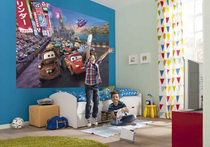 Disney Cars Wall Mural And White Trundle Bed Unit With Blue White Bedcover Also Green Round Rug In Kids Bedroom