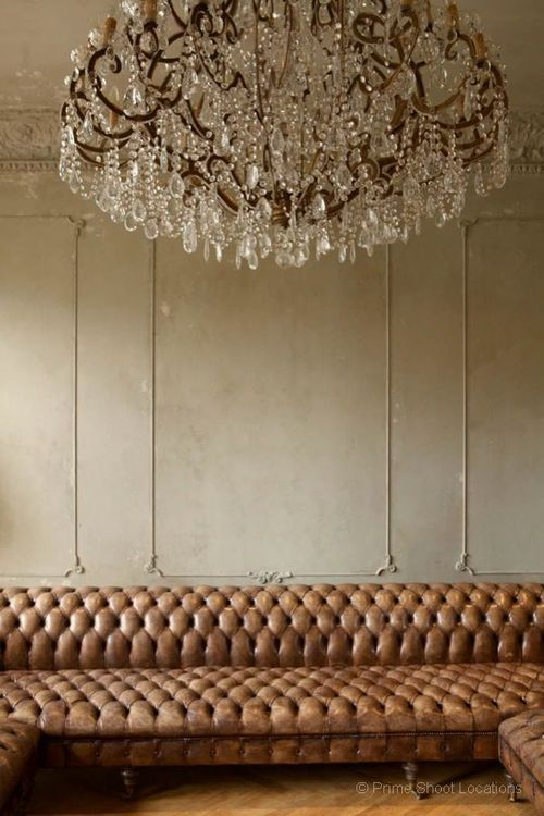 Chandelier and brown leather sofa - more interior design inspiration on Interiorator.com