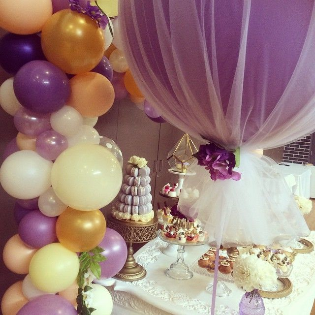 A close up of our lavender tulle 3ft balloon & abstract arch Styling, cakes & cupcakes by @cakesbyjoannecharmand + full list of vendors on her page.