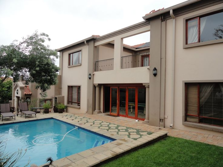 For Sale in Featherbrooke Estate. This 5 bedroom double storey house has large living and entertainment areas, beautiful kitchen and study with solid wood, built-in cupboards etc ..... Full domestic accommodation, pool, 4 garages and more ..... Upper R 5 million mark, call me on 072 264 7806