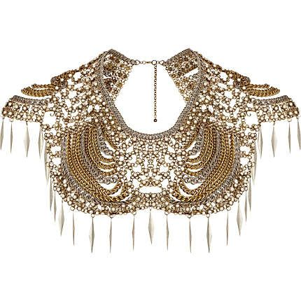 This statement necklace. Over a strapless gown.