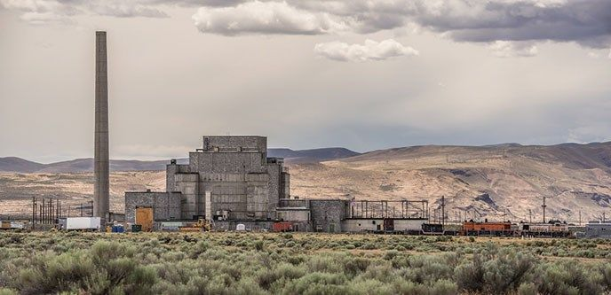 B Reactor in Hanford, Washington with hills in the background, This is where they made the plutonium for the manhattan project that assembled the 1st Atomic Bomb.