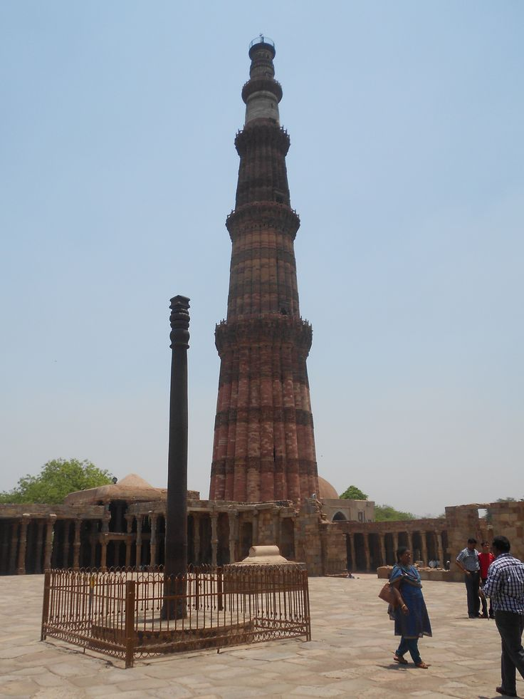 Qutb Minar India and famous oldest iron pillar, Delhi.  It just doesn't rust!!