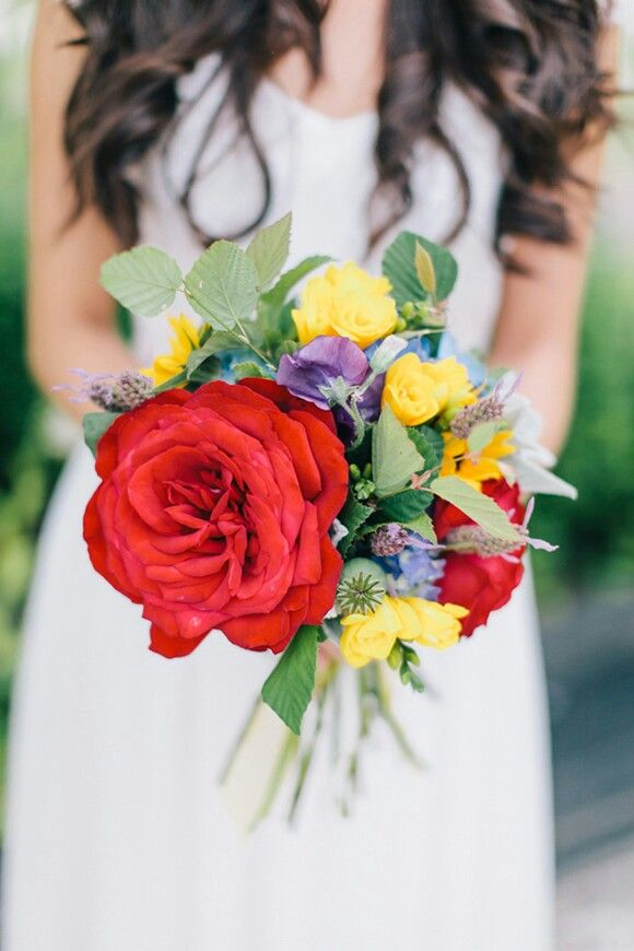 Vibrant & Petite Bridal Bouquet Showcasing: Big Red Garden Roses, Blue Hydrangea, Yellow Freesia, Purple Sweet Pea, Lavender, Green Seeded Eucalyptus & Additional Greenery/Foliage