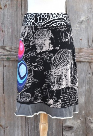 Cute and sassy, this black Desigual skirt is marked on the waist band by silver patterns. The body of skirt sports beige graffiti and colorful embroidered circles. Finished with two small layers of grey and cream fabric at the trim. #ourchoix, $68