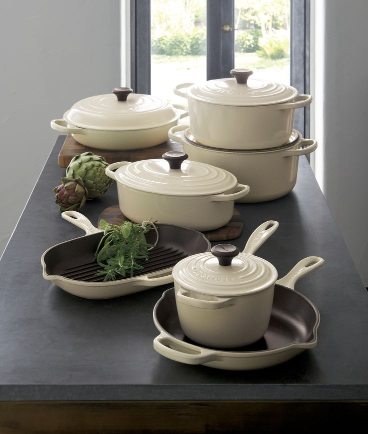 In a fresh cream color you'll find only at Crate and Barrel, our cast iron cookware is clad in smooth, vitrified porcleain, rendering each piece impervious to acid, alkali, odors and stains. Non-reactive cooking surface does not require seasoning. Compatible with all types of heat sources, from gas and electric stoves, to ceramic and glass cooktops, to induction and halogen—even solid fuel and open fire.