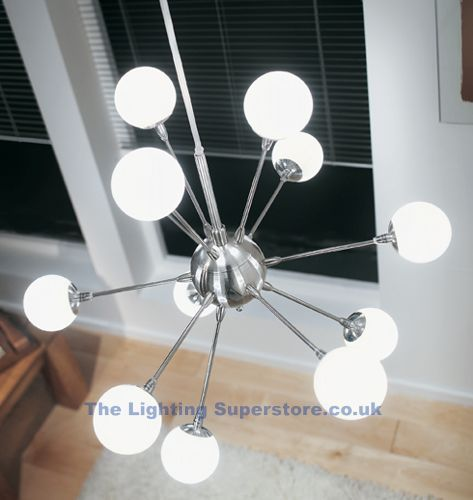 2012 12 Atom Modern Pendant - Satin silver finish 12 light pendant complete with white globe glass. (Adjustable Height)Supplied wi