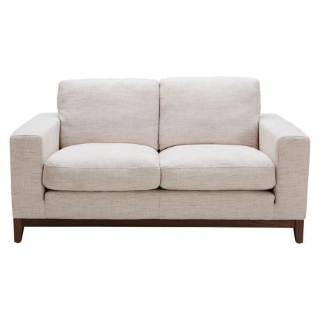 Easy-care fabric, a warm mid-tone wood accent and plush cushions make the Zahra a stylish and cosy sofa to stretch out on, day after day. Its soft, oversized cushions make it a style- and comfort-statement piece for your living room.