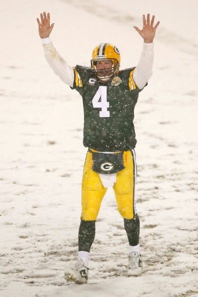 Brett Favre Photos Photos - Quarterback Brett Favre #4 of the Green Bay Packers celebrates after the Packers scored a touchdown against the Seattle Seahawks during the NFC divisional playoff game on January 12, 2008 at Lambeau Field in Green Bay, Wisconsin. The Packers defeated the Seahawks 42-20 to advance to the NFC championship game. - Seattle Seahawks v Green Bay Packers