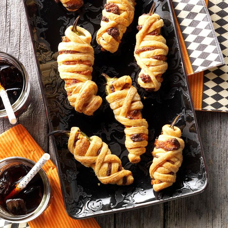 Mummy Poppers Recipe -I wrapped these spicy jalapeno poppers in puff pastry like a mummy. You can tame the heat by adjusting the amount of chipotle peppers.—Nick Iverson, Milwaukee, Wisconsin