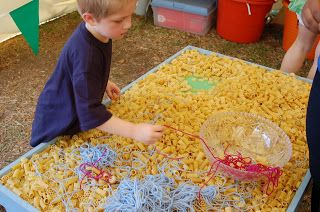 Make A Necklace with Macaroni Table - Easy craft for the kids at the Fall Festival