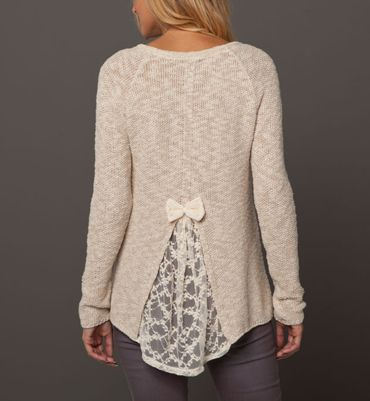 Easy - cut back of a sweater that's too small and insert lace. Cutting higher will make sweater looser in chest and neck. The wider the lace the more give.