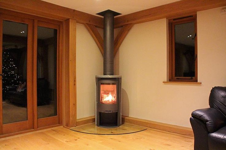 @ConturaStoves Grey 560 T soapstone #woodstove on a glass hearth with @PoujoulatUK Chimney system