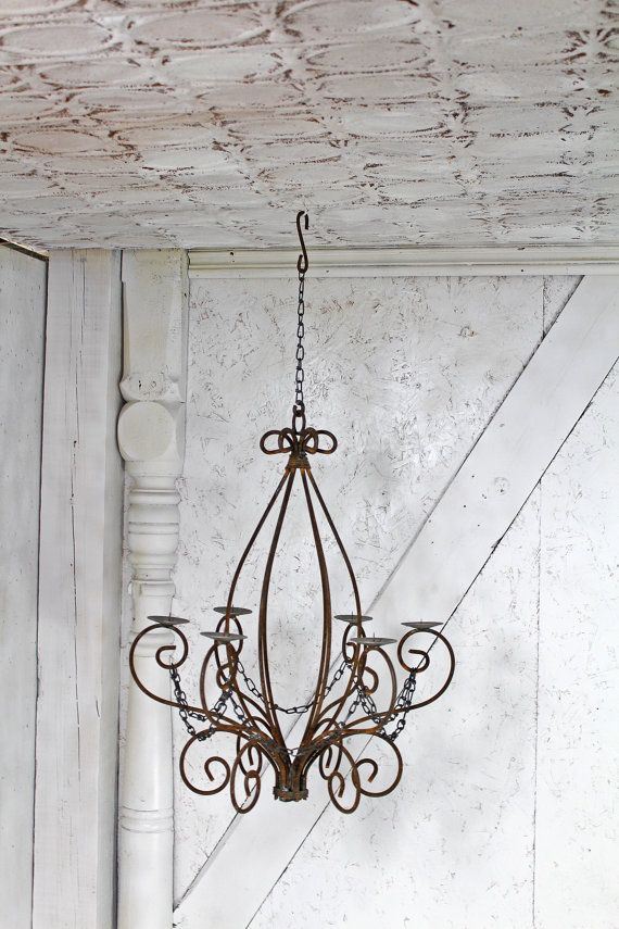 We have added an edgy twist to our wrought iron candle chandeliers by adding rustic chain. Notice that we also have chain and a hook at the top for