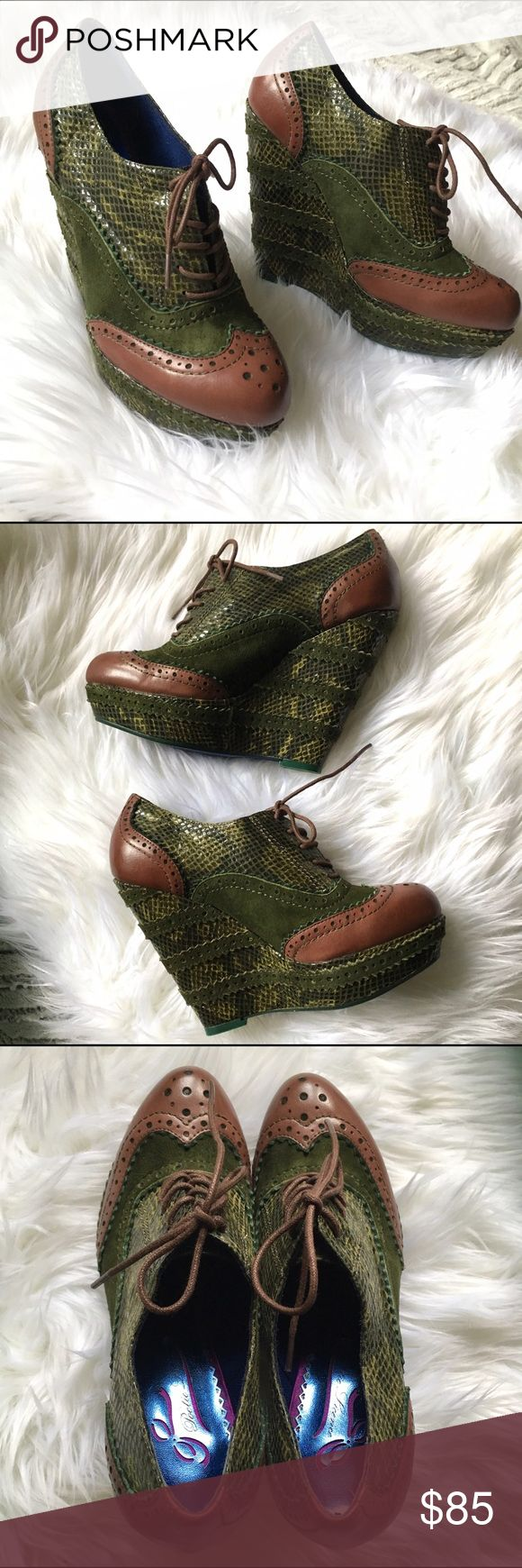 """Poetic License Wild Safari Green Wedge Oxfords Poetic Licence Wild Safari wedge-heel oxford. platform shoe with snake-printed leather upper, fabric lining and lightly cushioned footbed lend interior ease. Has durable rubber sole for lasting wear and reliable stability. Leather. New in Box!  Imported Rubber sole Heel measures approximately 4.5"""" Platform measures approximately 1.25"""" Rubber sole Fabric lining Covered heel Lightly cushioned footbed Snake-printed leather upper Poetic License…"""